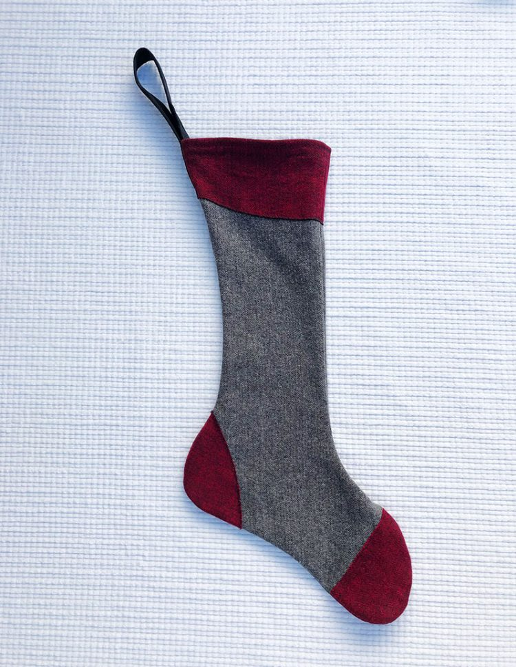 100% cotton flannel stocking with gray body and maroon accents at cuff, toe and heel